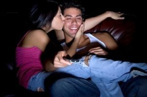 couple watching movie and kissing