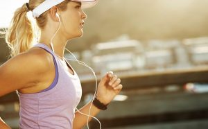 woman listening to music and running