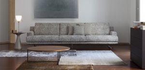 minimal saloni me trithesio kanape kai stroggilo ksilino-siderenio trapezaki kafe