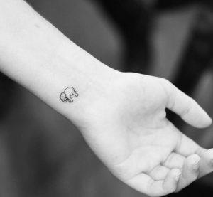 mini elephant tattoo
