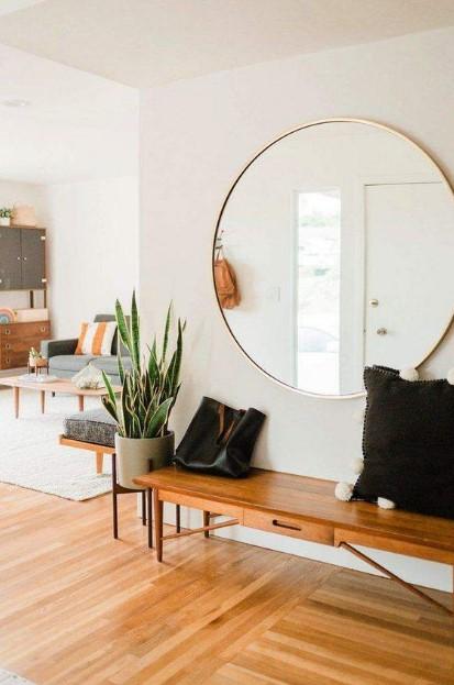 μεγάλος στρογγυλός καθρέπτης σαλόνι διακοσμήσεις τοίχους σαλόνι