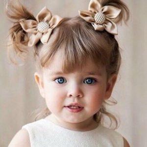 κοριτσακι με μαλλια κοτσιδακια