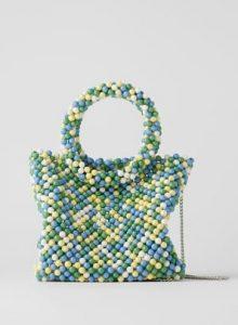 τσάντα με χάντρες και στρογγυλό χερούλι