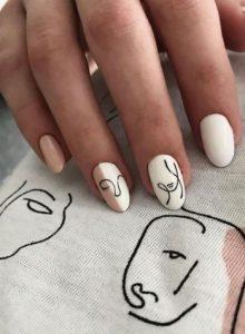 άσπρα νύχια με μαύρα σχέδια
