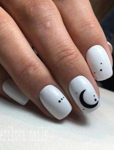 άσπρα νύχια με μαύρο σχέδιο
