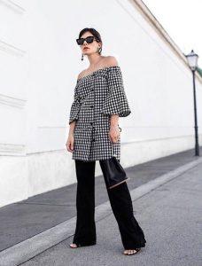 ασπρόμαυρο φόρεμα μαύρο παντελόνι