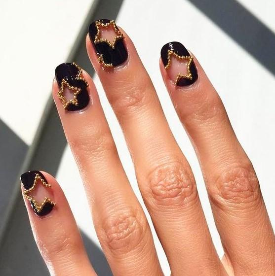 μαύρα νύχια αστεράκια χρυσά