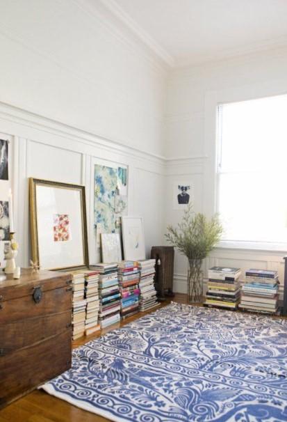 βιβλία πάτωμα πίνακες γαλάζιο χαλί