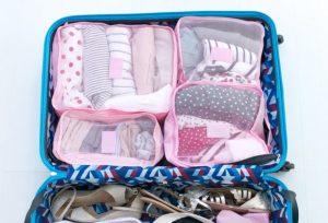 πακετάρεις σε μικρή βαλίτσα με ρολά