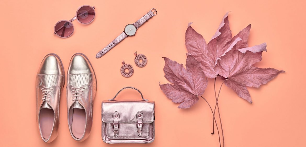 Fall fashion Accessories set. Autumn mood, creative Flat lay. Trendy Sunglasses, Stylish gold loafers shoes, glamour handbag, fashionable look. Autumnal color layout, Maple Leaf