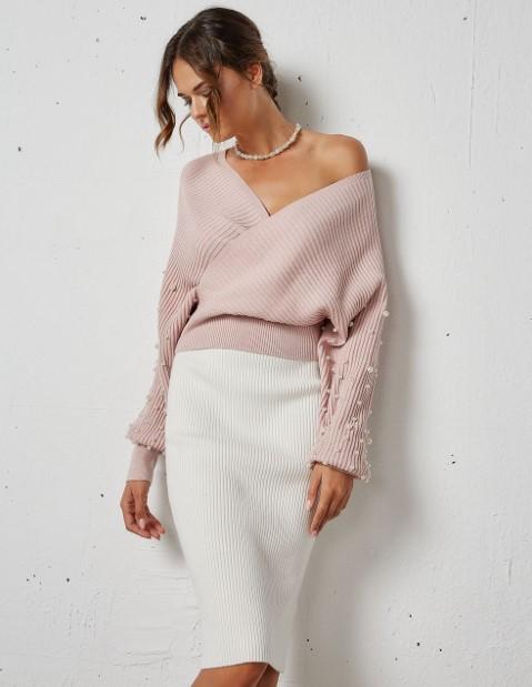ροζ πουλόβερ πέρλες